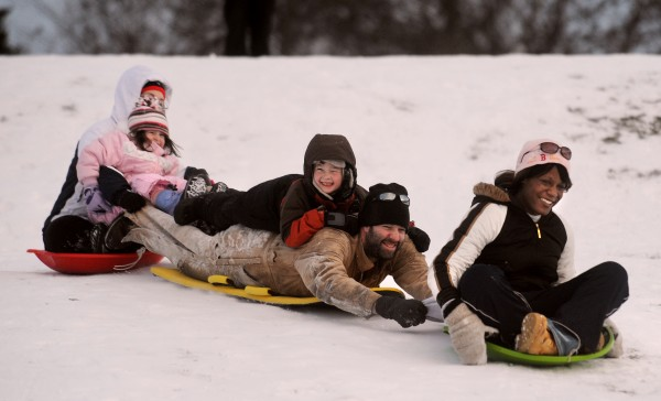 Members of the Norris family slide down the hill at Hayford Park in Bangor on Christmas Day in 2010.