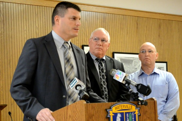 Maine State Police Lt. Christopher Coleman of the Major Crimes Unit addresses the media during a press conference in the Waterville City Council chambers on Wednesday, Dec. 5, 2012. Waterville police Chief Joe Massey (center) and Sgt. Mike Benecke look on.