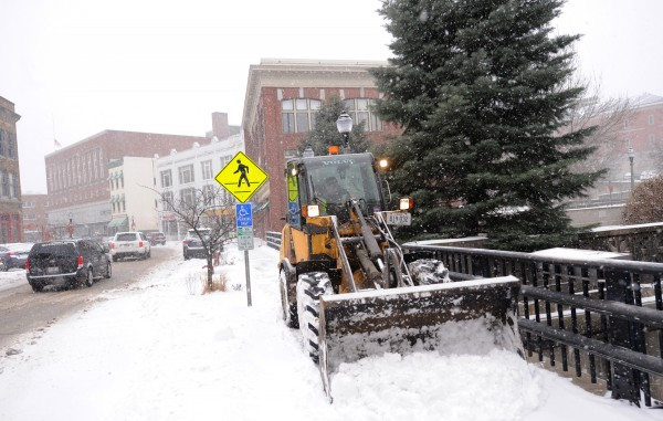 A city employee works on plowing the city sidewalks in downtown Bangor on Thursday morning.