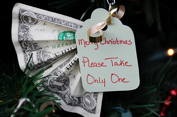 This dollar, along with other money donations, is clipped to the Bangor Elves' small holiday tree in downtown Bangor in December 2011.