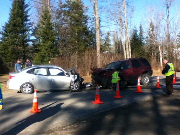 Waldo County sheriff's deputies work to reconstruct a collision on the Monroe Road in Winterport on Thursday morning.