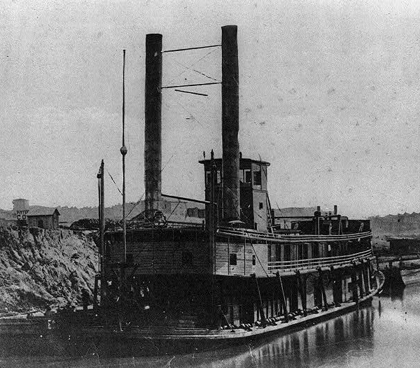 The USS Brown, a sternwheeler steamboat converted into a Navy gunboat, lies docked along a Mississippi River bank sometime during the Civil War. In a letter written on Christmas Day 1862, a soldier from Co. A, 14th Maine Infantry, mentioned seeing a similar gunboat steam past his company's post some miles upriver from New Orleans just nine days earlier.