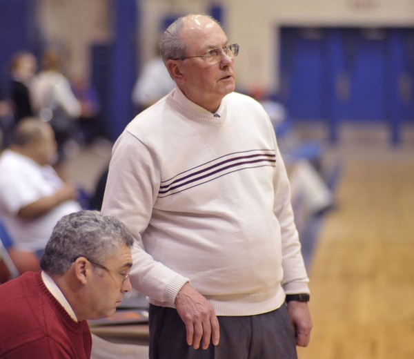 Bangor boy's basketball coach Roger Reed makes some player notes to assistant coach Joe Nelson in pregame warm-up before their game against the Medomak Valley boy's team in preseason action at the Bangor Auditorium in November 2011.