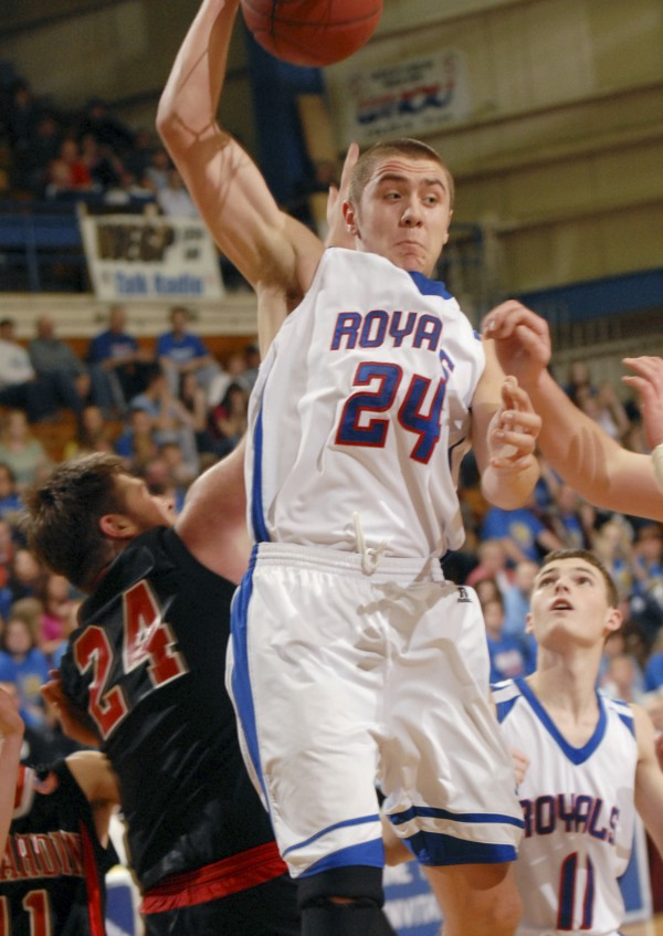 Royals #24 Garet Beal pulls down a rebound during second half action versus Katahdin at the Bangor Auditorium in February 2012.