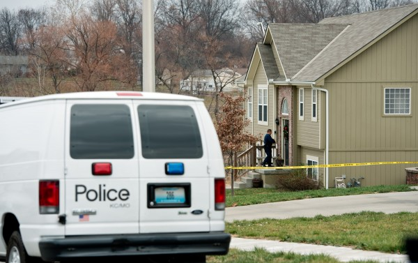 Crime scene investigators enter a home in Kansas City, Missouri, investigating the death of Kasandra Perkins, girlfriend of Kansas City Chiefs linebacker Jovan Belcher, who on Saturday shot and killed his girlfriend before going to Arrowhead Stadium and fatally shooting himself.
