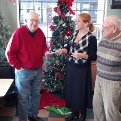 Historical society's holiday ceremony collects $200 for Bath Area Food Bank
