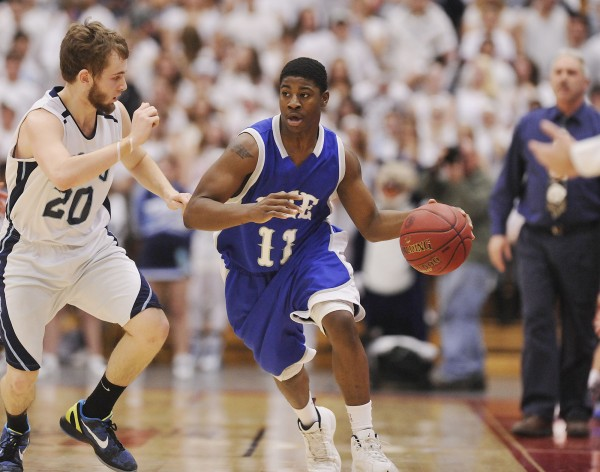 Lee Academy's Jasil Elder (11) drives down the sideline under pressure from Dirigo's Josh Turbide during the Class C state final last season.