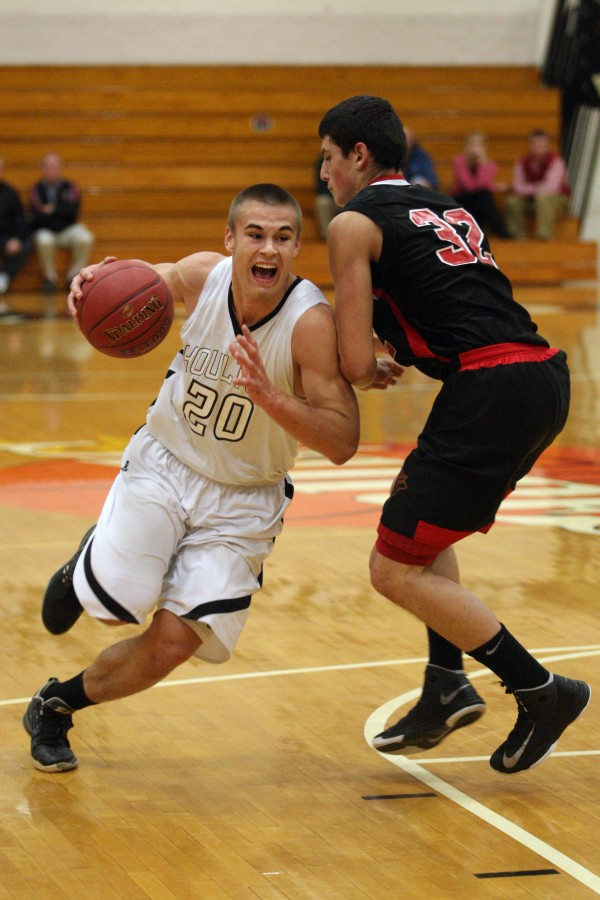 Kyle Bouchard (left) of Houlton drives past Katahdin's Colton's Bivinghouse during an exhibition game Nov. 29 in Houlton. The sophomore is one of several key returnees for the Shiretowners this season.