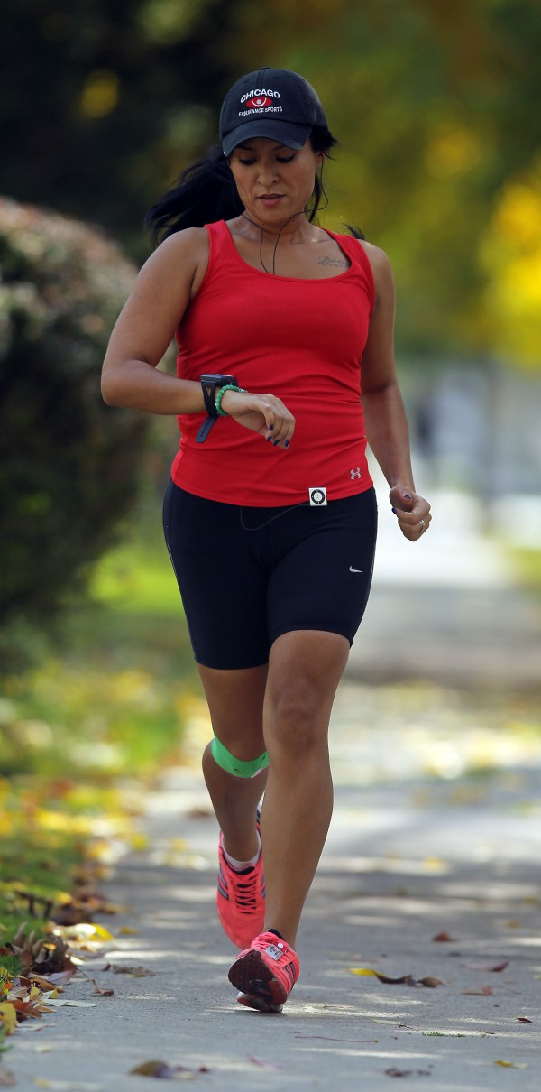 Experts say factors such as wind and weather cause you to burn 5 to 7 percent more calories when you exercise outside. Here, Daisy Carranza goes for a short run on Austin Boulevard in Chicago, on Oct. 4, 2012.