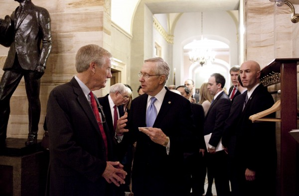 Sen.-elect Angus King, I-Maine, talks with Senate Majority Leader Harry Reid of Nev., on Capitol Hill in Washington on Wednesday, Nov. 14, 2012, after King announced that he will caucus with the Democrats in the 113th Congress.