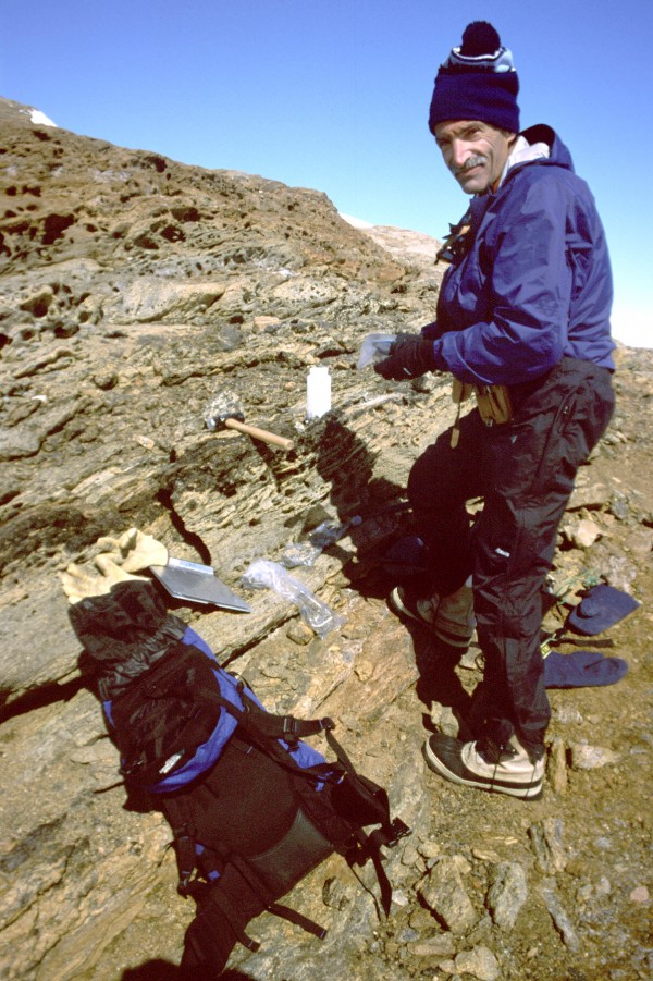 "University of Maine geologist and research professor Edward Grew collects samples in Antarctica. Russian geologists at the University of Silesia in Poland have discovered two minerals new to science and have named them ""Edgrewite"" and ""hydroxledgrewite"" in honor of Grew."