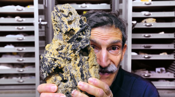 Edward Grew, a geologist and research professor at the University of Maine, holds a rock sample from Antarctica that contains the mineral prismatine. Grew has discovered several minerals himself and he was instrumental in the revalidation of prismatine. Russian geologists Evgeny Galuskin and Irina Galuskina named two recently discovered minerals Edgrewite and hydroxyledgrewite in honor of Grew who has been working in this field for over 40 years.