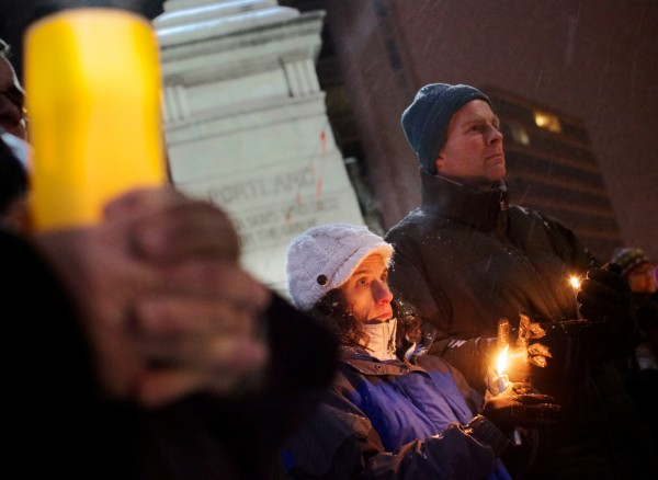 Rachael Flaxman and Todd Brydson hold candles in Portland's Monument Square on Sunday night Dec. 16, 2012 during a vigil organized by Maine Citizens Against Handgun Violence in response to the Connecticut school shooting Friday.