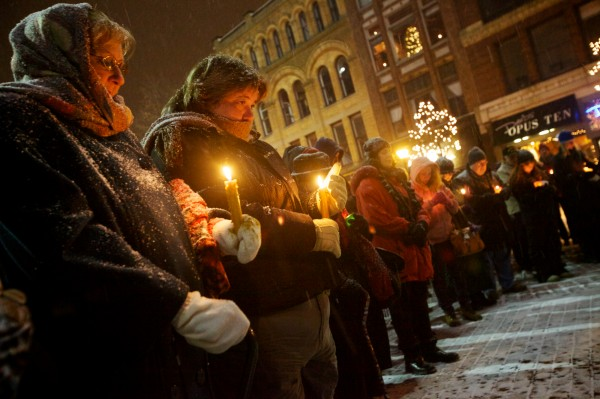Concerned citizens hold candles at a vigil in Portland's Monument Square on Sunday night Dec. 16, 2012. The vigil was organized by Maine Citizens Against Handgun Violence in response to the Connecticut school shooting Friday.