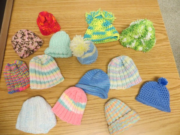 In Eastern Maine Medical Center's critical care nursery, a collection of hats, knit by Phyllis Nodine and others, awaits new owners who need to be kept warm.