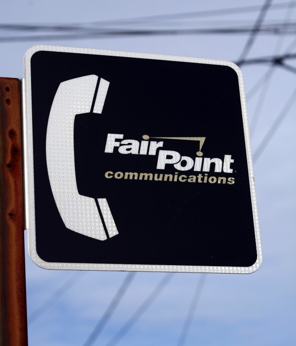 A FairPoint Communications sign is shown in front of various transmission lines in Portland on Monday, Feb. 8, 2010.