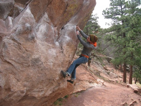 Kim Robichaud of Orrington warms up on a boulder in Eldorado Canyon in Colorado.