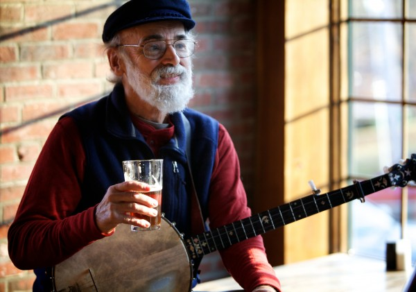 Folk singer Charlie Ipcar wets his whistle after singing a song adapted from a Cicely Fox Smith poem at the Old Goat pub in Richmond on Friday afternoon Dec. 14, 2012. Ipcar, along with James Saville, published &quotThe Complete Poetry of Cicely Fox Smith&quot this year.