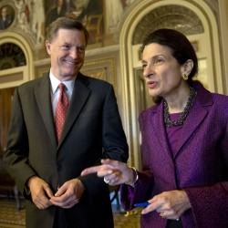 "Retiring Sen. Olympia Snowe, R-Maine, accompanied by her husband, former Maine Gov. John ""Jock"" McKernan, Jr., talks on Capitol Hill in Washington, Thursday, Dec. 13, 2012, after giving her farewell speech in the Senate chamber. Snowe said she remains hopeful that the Senate can overcome ""excessive political polarization"" to work together to reach consensus on important issues facing the nation."