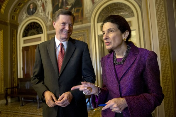 Retiring Sen. Olympia Snowe, R-Maine, accompanied by her husband, former Maine Gov. John &quotJock&quot McKernan, Jr., talks on Capitol Hill in Washington, Thursday, Dec. 13, 2012, after giving her farewell speech in the Senate chamber. Snowe said she remains hopeful that the Senate can overcome &quotexcessive political polarization&quot to work together to reach consensus on important issues facing the nation.