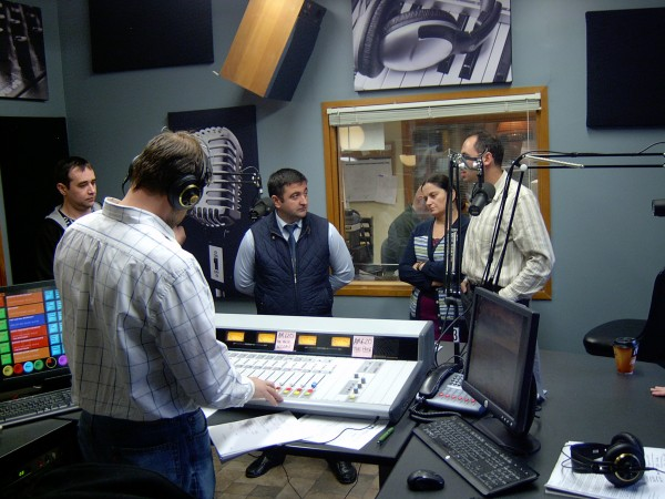 Aslan Ismailov, Khanpash Aydamirov, and Zargan Makhadzhieva of the Chechen Republic (from left) and translator Mihael Blikshteyn (right) are interviewed by Don Cookson of WZON at the radio station in Bangor Friday.