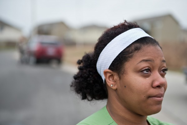 Brianna York, 21, of Kansas City, Missouri, weeps as she speaks about Kasandra Perkins, 22, who was murdered by her boyfriend, Kansas City Chiefs linebacker Jovan Belcher, on Saturday morning, Dec. 1, 2012. Belcher then drove to the team's practice facility at Arrowhead Stadium and fatally shot himself, police said.