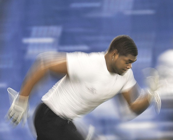 UMaine's Jovan Belcher performs in the timed dash portion of the NFL scout evaluation for  signing with a pro football team, Thursday, March 26, 2009, in the Mahaney Dome at the University of Maine.