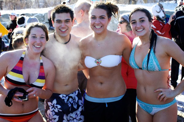Friends (from left) Rebecca Belaire, Eric Vattaso, Sarah Lecroix and Abby Goulet steam in the cold air after emerging from the frigid waters of Casco Bay at Portland's East End Beach on Monday, Dec. 31, 2012 at the Natural Resources Council of Maine's annual New Year's Eve Polar Bear Dip and Dash fundraiser.