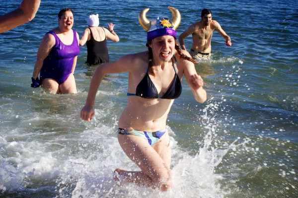 Winter dippers emerge from the frigid waters of Casco Bay at Portland's East End Beach on Monday, Dec. 31, 2012 at the Natural Resources Council of Maine's annual New Year's Eve Polar Bear Dip and Dash fundraiser which includes a 5k run and a quick dunk in the water.