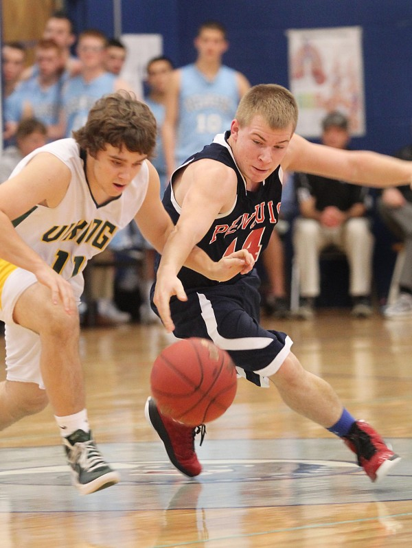 Penquis Valley High School's Cody Larabee battles for the ball with Oxford Hills High School's Adam Kenney during the second half of the Patriots' 58-57 win in a preseason tournament held at Lawrence High School in Fairfield on Saturday.