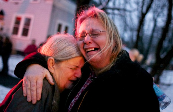 Susan Savage (left) embraces Wendy Shea after their home, a duplex at 108 Third St. in Bangor, caught fire Thursday afternoon leaving them without a home for the holidays.