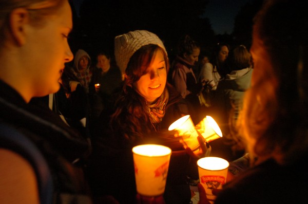 University of Maine students, including junior Josceline Dupuis (center) participate in the 25th annual Take Back the Night rally and vigil Tuesday, Oct. 6, 2009, on the Orono campus to raise awareness of sexual and domestic violence.