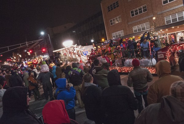 Spectators line Main Street to the corner of Hammond Street  in the Festival of Lights parade on Saturday.
