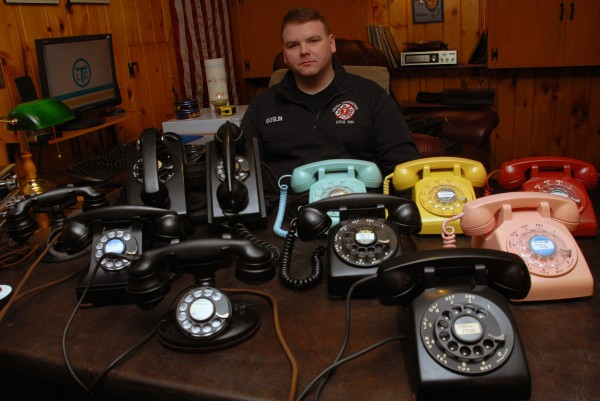Lincoln Fire Department Engineer Ken Goslin's love of old rotary telephones, as seen here in his basement man cave, bailed firefighters out when their station telephone system died last week.