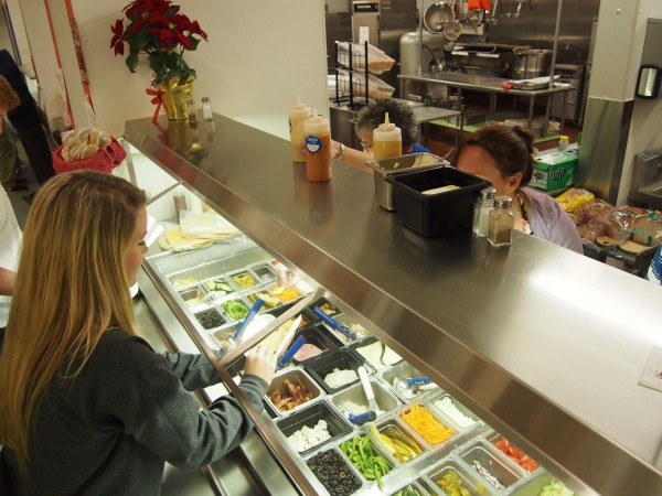 Students wait in line at the sandwich bar week at Yarmouth High School. Yarmouth schools, like most others in southern Maine, have passed health inspections for the last five years, according to a  Forecaster review of more than 200 inspection reports.
