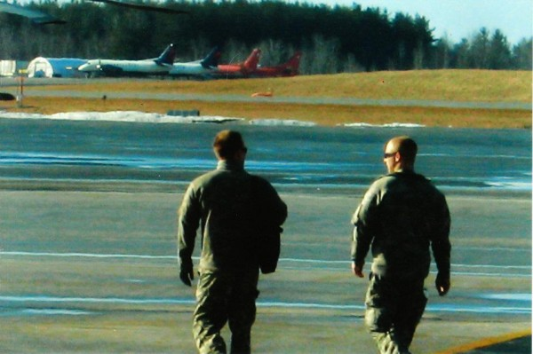 Spc. Philip Higgins (right), a crew chief for the 126th Aviation Medevac unit in Bangor, is one of 120 members deployed to Kuwait during the holidays. The unit is expected back in February.