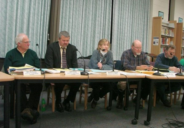 School Administrative District 51 board member Martha Leggat (center), of North Yarmouth, discusses the emotional gravity of the proposal to close North Yarmouth Memorial School during a meeting Monday night, Dec. 17, 2012, at Greely High School in Cumberland. Other board members are (from left) co-chairmen Bill Richards and Jeff Porter, Jim Moulton and Bob Vail.