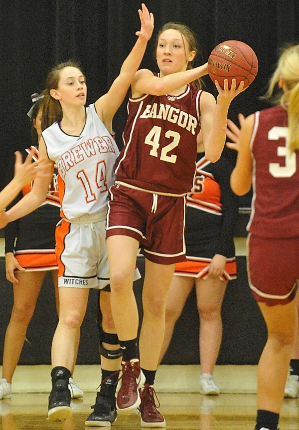 Bangor High School's Mary Butler (42) looks to pass as Brewer High School's Lindsay Houp (14) pressures her under the Bangor basket during a game last season. The two rivals meet at 7 p.m. Friday night in Brewer.
