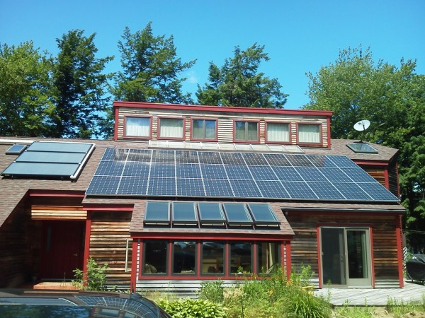 A house on Branch Lake in Ellsworth is outfitted with solar panels.