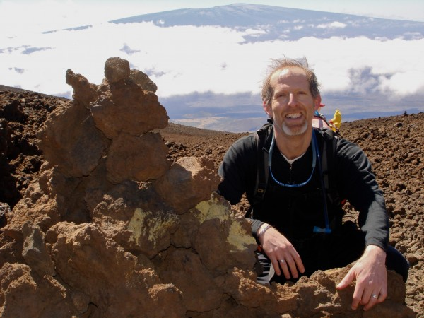 David B. Williams, author of &quotCairns: Messengers in Stone,&quot published October 2012, sits beside a cairn on Mauna Loa on Hawaii. In Hawaii, these rock piles are known as &quotahu.&quot