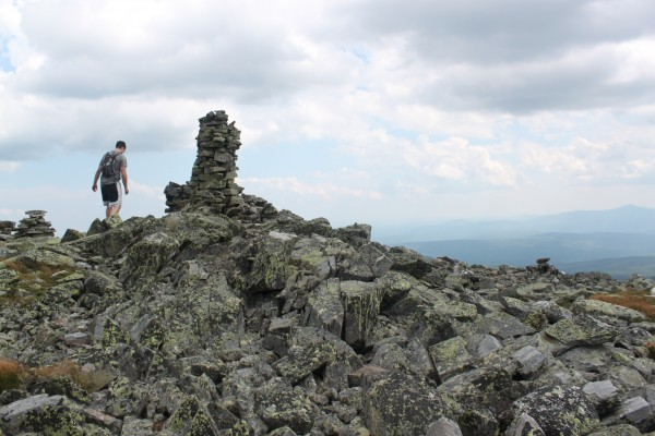 Derek Runnells walks past a massive cairn near the summit of Mt. Abraham near Kingfield on Aug. 3.