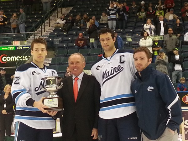 University of Maine hockey captains (from left) Mike Cornell, Mark Nemec and Joey Diamond pose with Florida Everblades President Craig Brush and the championship trophy Saturday night after beating Cornell 5-2 to win the Florida College Classic in Estero, Fla.