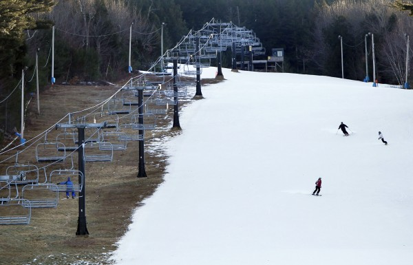 "Man-made snow coats a ski run but barren ground remains under a chairlift at Shawnee Peak ski area, Thursday, Jan. 5, in Bridgton.  A national study released today argues that climate change, if left unaddressed, will have ""severe negative impacts"" on winter tourism economies, including Maine's."