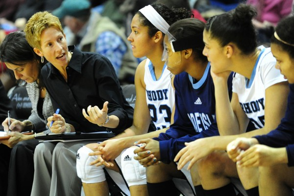 Rhode Island assistant basketball coach Cindy Blodgett talks to some of her players during their game in Kingston, R.I., against Delaware on Wednesday, Dec. 5, 2012.