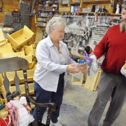 Randy Elliot of Corinth (right) makes wooden doll cradles and toy cars and Norma Leighton of Stetson refurbishes donated dolls. The toy go to children who would not otherwise have Christmas presents. Elliot has been making cradles since 1991 and now makes well over 1000 toys that are  donated to children all over the state.