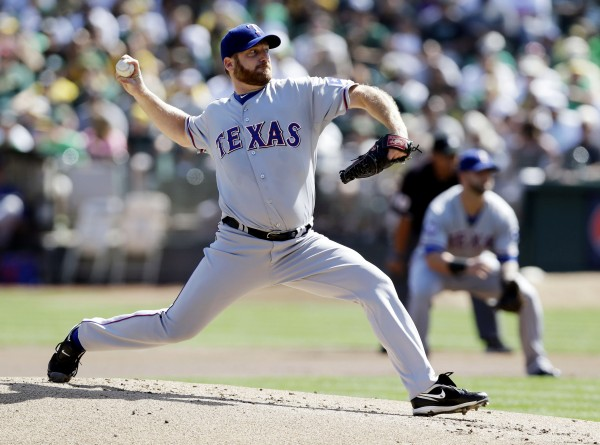 Texas Rangers starting pitcher Ryan Dempster throws against the Oakland Athletics on Oct. 3. The Boston Red Sox have agreed to terms with  Dempster on a two-year contract worth $26.5 million, according to two people familiar with the negotiations.