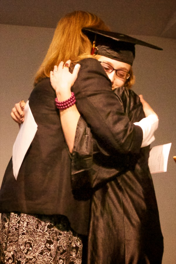 Youth Building Alternatives graduate Rianna Tuttle hugs program director Soni Waterman at graduation Friday Dec. 14, 2012 in Portland.