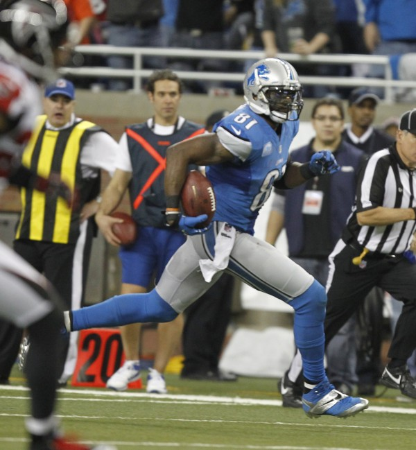 Detroit Lions wide receiver Calvin Johnson with his record-setting reception in the fourth quarter against the Atlanta Falcons at Ford Field in Detroit, Michigan, on Saturday, Dec. 22. Johnson's catch lifted him over Jerry Rice for the NFL's single-season receiving yardage record.