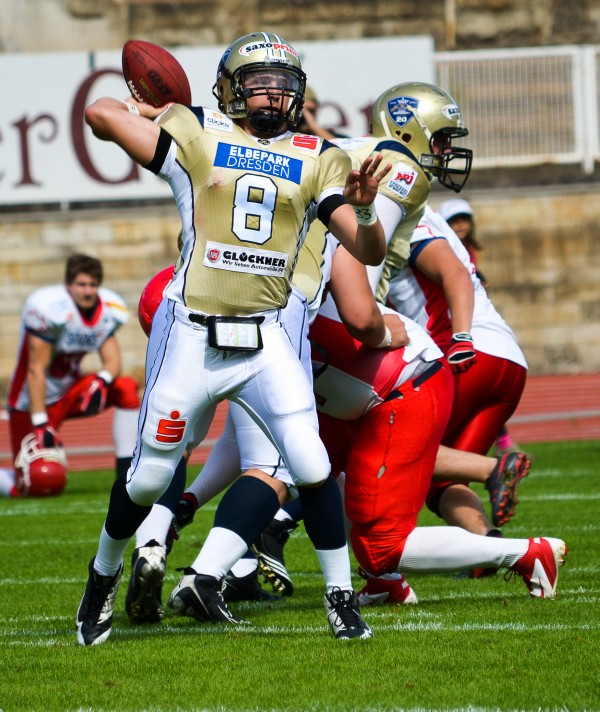 Former University of Maine quarterback Warren Smith throws a pass last season while playing for the Dresden Monarchs of the German Football League.
