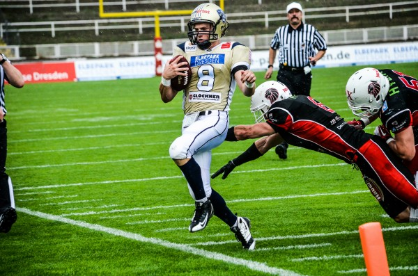 Dresden Monarchs quarterback Warren Smith is chased out of bounds during a German Football League game last summer. The former University of Maine standout is now hoping to earn a roster spot on a U.S. professional team.